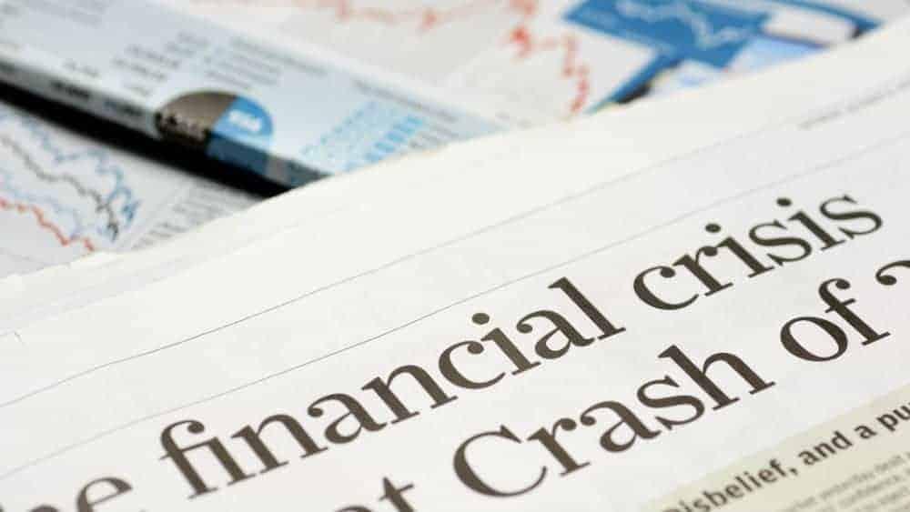 Close up of newspaper headline for financial crisis news