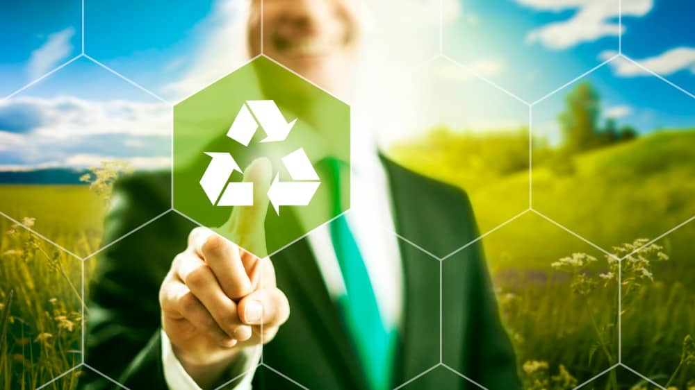 Man pointing at a recycling symbol